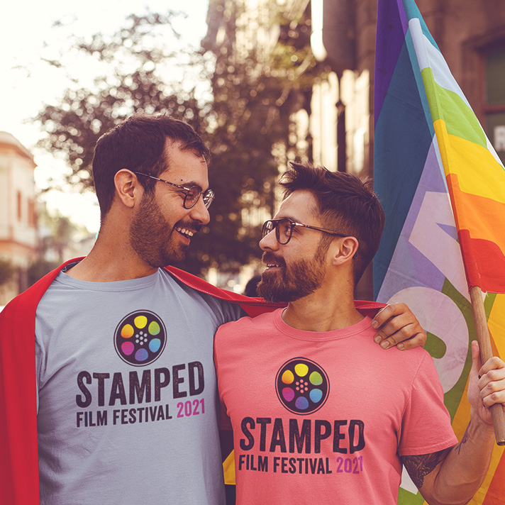 2021 STAMPED Film Fest featured event image for Foo Foo Festival. Features two gay men wearing Stamped Film Festival tshirts with gay pride flag in hand.