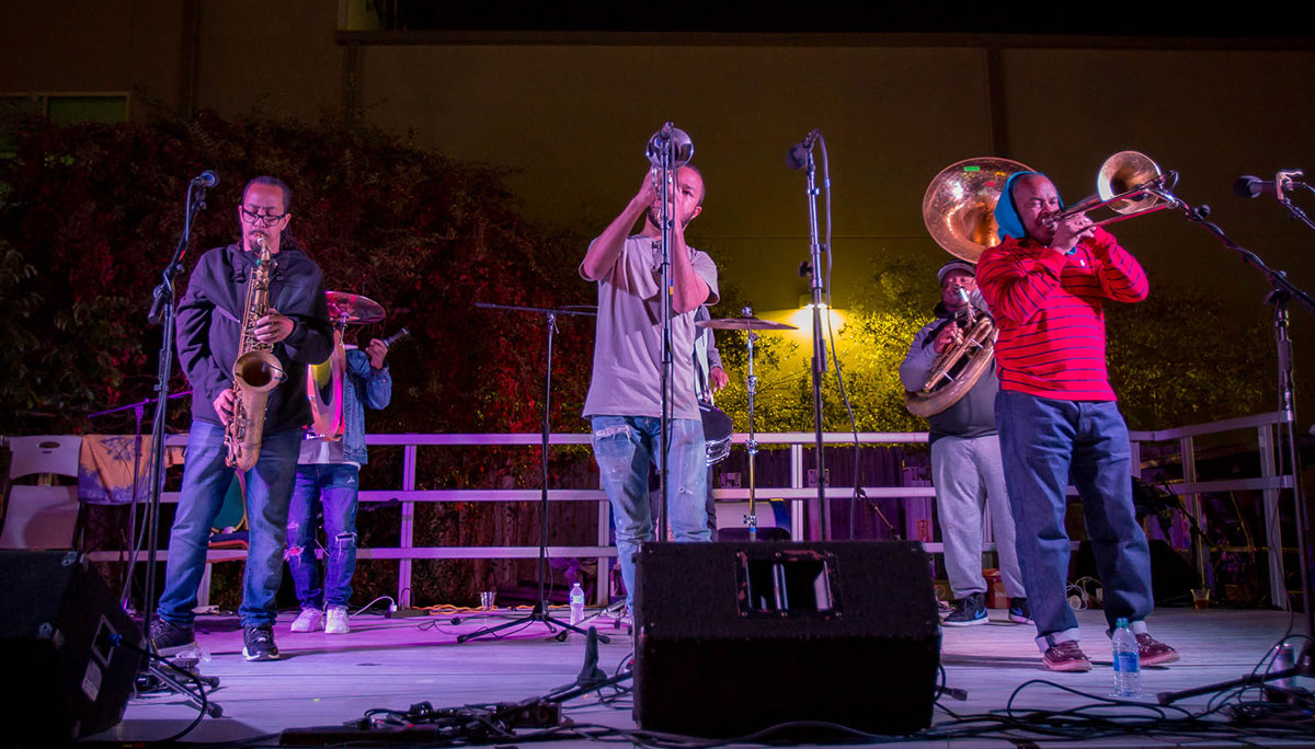 Photos depicting various artists performing at Jazz for Justice