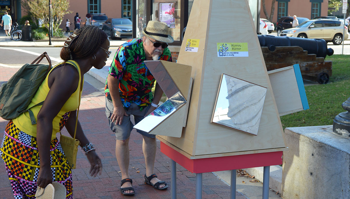 Photos depicting various science on the street events by the MESS Hall