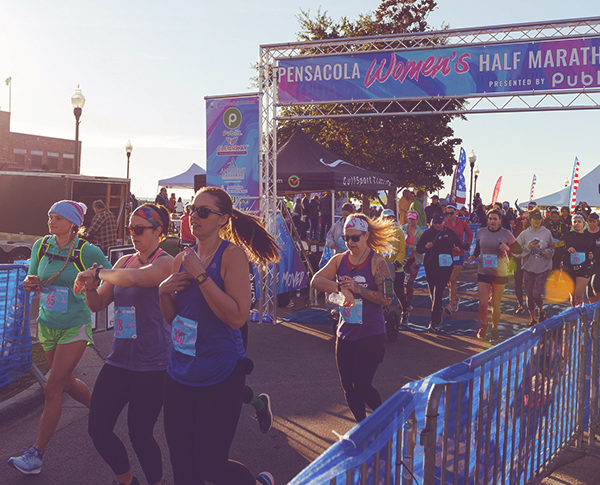 women start the pensacola women's half marathon in downtown Pensacola