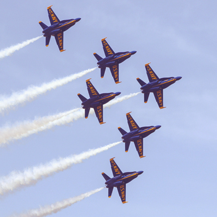 The primary 6 F-18 Super Hornets of the US Navy Blue Angels flies through the blue sky above Pensacola